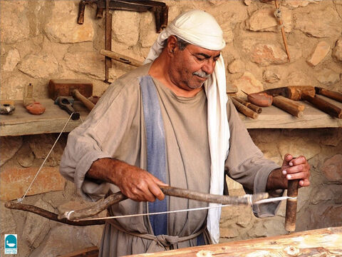 Some carpenters worked with a bow drill. A bow string would be twisted so it could turn a drill. It could also turn wood, allowing the carpenter to shape it with chisels, a form of early lathe. – Slide 11