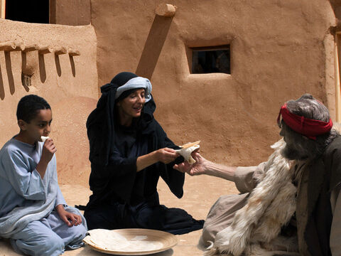 The woman uses the last of her flour and oil to bake bread and shares it with her son and Elijah. – Slide 11