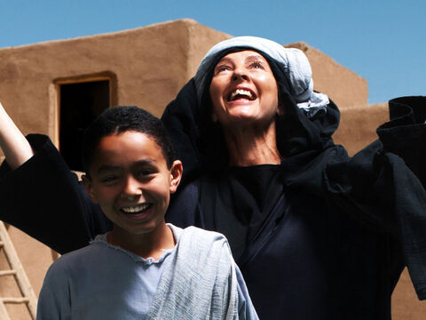 The widow and her son are amazed how Elijah's God has provided for them all. – Slide 14