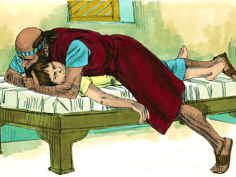 He stretched his body out on the boy and the boy's body grew warm. Elisha walked up and down the room then lay on the boy again. The boy sneezed seven times and opened his eyes. – Slide 15