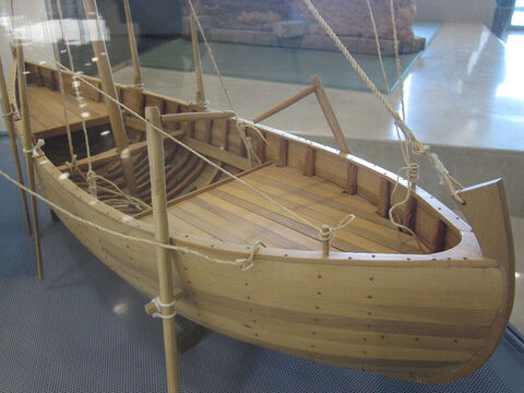 This model of the boat shows you what it would have looked like. The boat was constructed primarily of cedar planks joined together by pegged mortice and tennon joints. It has a shallow draft with a flat bottom, allowing it to get very close to the shore. – Slide 12