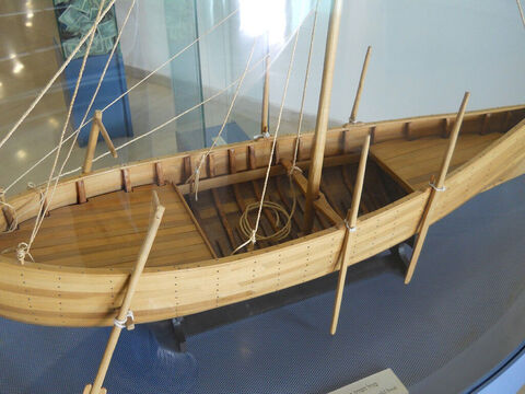The boat could have been sailed or rowed. It would have used a single square sail affixed amidships. Based on the vessel's size, it probably would have had a basic crew of five to four rowers and a helmsman. The boat would have been steered by means of two steering oars. – Slide 13