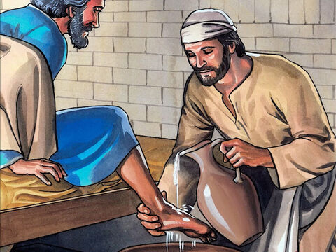 Jesus poured water into the washbasin and began to wash the disciples' feet and to dry them with the towel He had wrapped around himself. – Slide 6