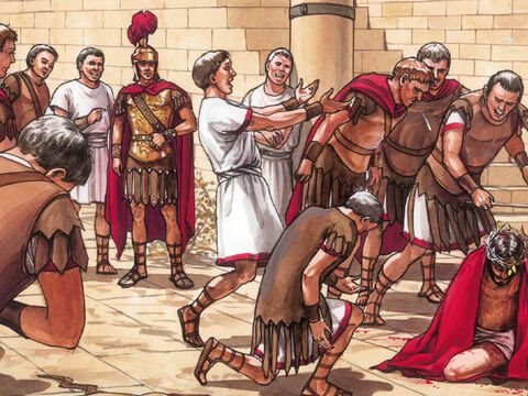 Then the Governor's soldiers took Jesus. They stripped Him, put a scarlet robe around Him, a crown of thorns on His head and kneeling down before Him they mocked Him, 'Hail King of the Jews.' – Slide 1