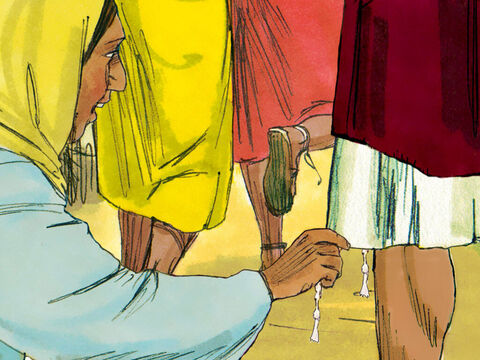 The woman reached down and touched the edge of Jesus' garment. Immediately her bleeding stopped and she felt well. Note: On the four corners of the Jewish prayer shawl were four tassels, ortzitziyot. These tassels were to remind each Jewish man of his responsibility to fulfill God's commandments but also came to represent that man's authority (Numbers 15:37-41). – Slide 7