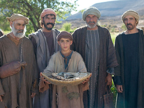 Andrew, Simon Peter's brother, spoke up. 'There's a young boy here with five barley loaves and a couple of fish! But what good is that with all these mouths to feed?' – Slide 11