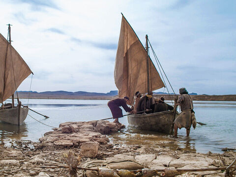 The other disciples followed in the boat, towing the net full of fish. They were only about a hundred yards (100m) from the shore. – Slide 9
