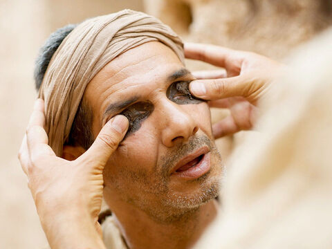 Then Jesus spat on the ground, made some mud with the saliva, and put it on the man's eyes. – Slide 4
