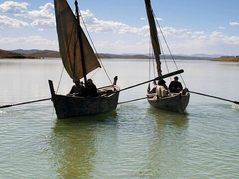 The fisherman took their heavily laden boats back to the shore. – Slide 12