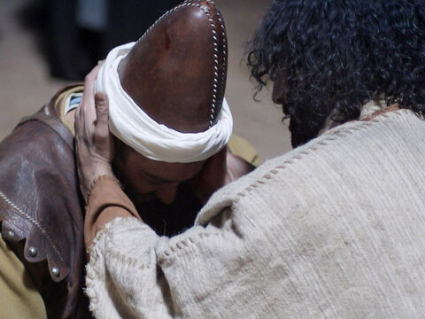 Jesus then touched the man's ear and healed him. – Slide 18