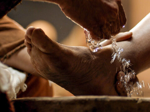 Then He poured water into a basin and began to wash His disciples' feet. – Slide 4