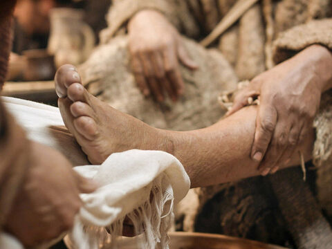 When Jesus had finished washing their feet, He put on His outer garment and returned to the table. – Slide 11