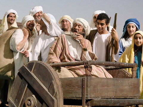 Everyone packed up their belongings for the trip to Egypt. Jacob was transported in one of the carts. – Slide 9