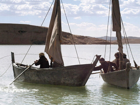 Most likely, Simon Peter and Andrew in one boat worked with James and John in another to suspend a long drag net between the boats. The boats would then be rowed to enclose a circular space and when the boats met the nets were hauled in. – Slide 18