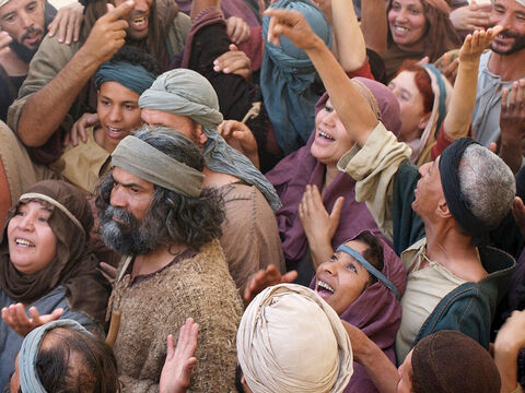 A large crowd followed them, hemming Jesus in from all sides as they pushed their way through the narrow streets. – Slide 5