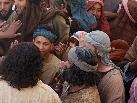 Although Jesus was being jostled in all directions by the crowd He knew that power had gone out from Him. He turned round and asked, 'Who touched my clothes?' – Slide 9