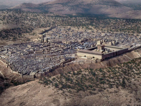 Aerial view of Jerusalem from the south-east with the Mount of Olives to the right. Within the city in the foreground left is the spur of the city of David, the Tyropoeon valley and behind that the Upper City. The Temple and Fortress of Antonia are within the city walls to the right. – Slide 10