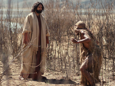 As Jesus stepped ashore, a man possessed by demons met Him. For a long time this man had lived wild among the tombs. – Slide 2