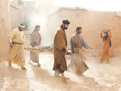Some men arrived carrying a paralysed man on a mat, hoping to bring him to see Jesus. – Slide 4