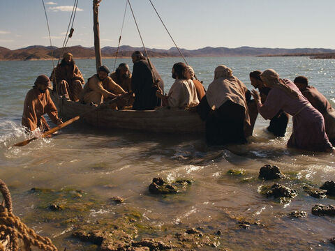 One evening Jesus said to His disciples, 'Come with me across the lake.' – Slide 1