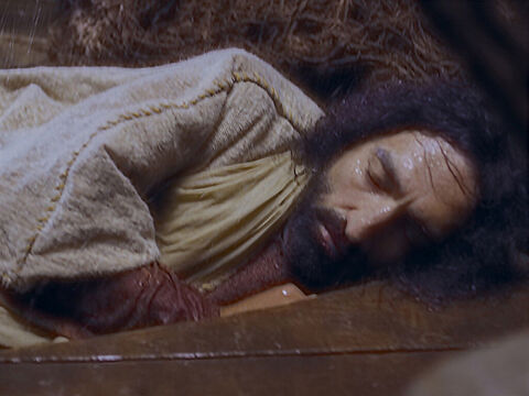 Jesus was in the back of the boat. He was tired and fell asleep with His head on a pillow. – Slide 3