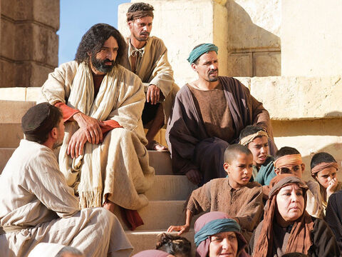Jesus sat down in the Temple opposite the place where people gave their offerings. – Slide 1