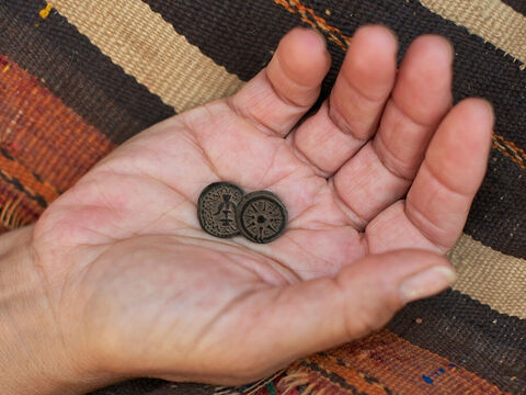 She had two very small copper coins, known as mites. The 'mite' (lepton in Greek) was the smallest of the bronze coins in Jewish currency. (A daily wage was worth around 64 mites). – Slide 9
