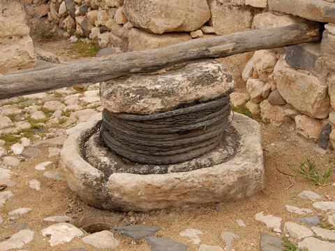 Baskets of olives were put under the crushing stone. – Slide 21
