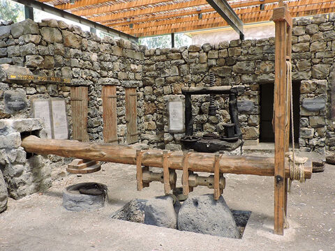 This is a reconstruction of an olive press in Israel. – Slide 24