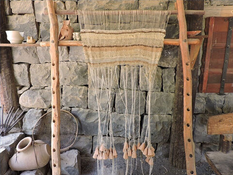 Lengths of yarn were hung from a top frame to fall vertically to the ground. – Slide 12